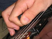 Harmoniques sifflées (pinched harmonics)